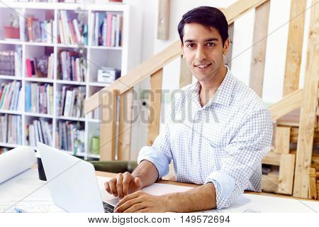 Young man architect in office