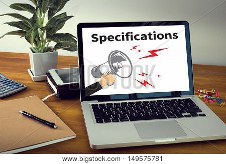 Specifications Laptop on table. Warm tone  businessman work hard hand touch