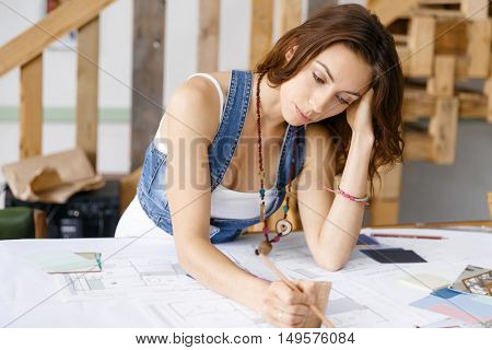 Young pretty woman at her desk