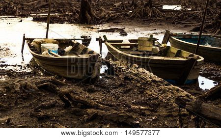 Sampan or row boat stranded on the bottom of a lake in dry season.