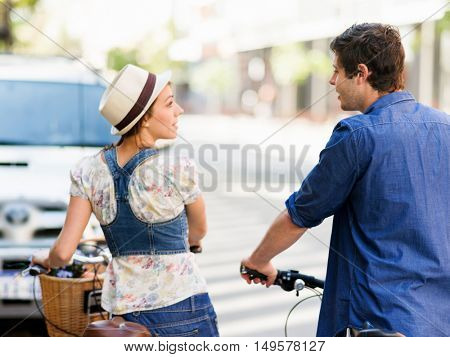 Happy couple in city with bike
