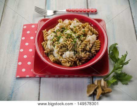 fusilli with fish and mushroom, selective focus