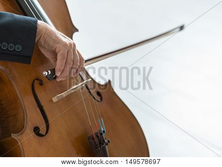 Professional male cellist playing his cello classical music solo performance