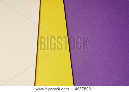 Colored cardboards background beige yellow purple tone. Copy space. Horizontal