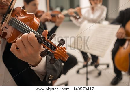 Violinist Performing On Stage