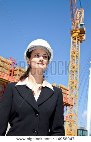 Woman with construction crane
