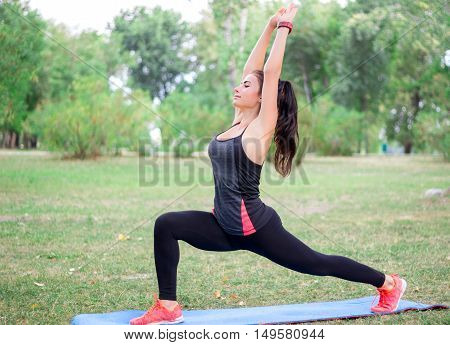 Young Fitness Girl Stretches While Training Workout