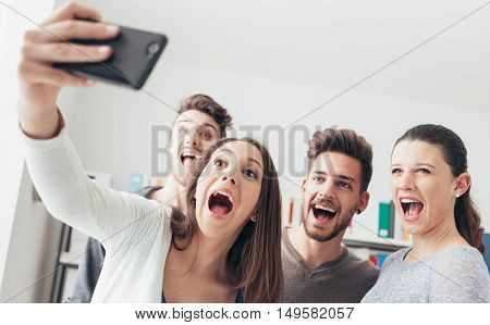 Teenagers Taking Selfies With A Mobile Phone