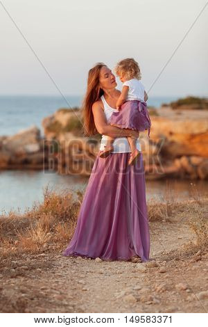 Portrait Of Happy Mother And Small Daughter