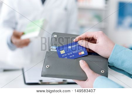 Woman Buying Products In The Pharmacy