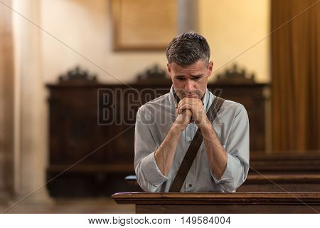 Man Praying In The Church