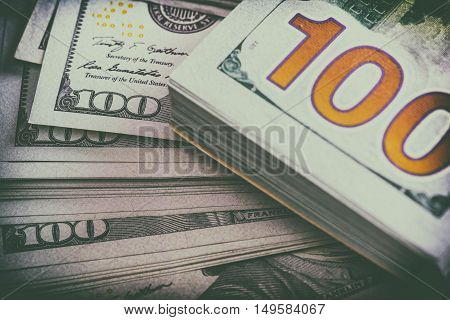 Lot of money. US dollar banknotes. Selective focus. Toned image