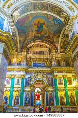 SAINT PETERSBURG RUSSIA - APRIL 25 2015: The St Isaac's Cathedral is one of the most famous landmarks in city with unique interior full of masterpieces of art on April 25 in Saint Petersburg.