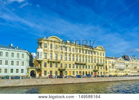 The embankment of Fontanka River boasts scenic mansions and historic apartment houses decorated with fretwork andcarved patterns St Petersburg Russia.