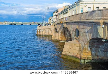 The granite Prachechny(Laundry) Bridge crossed the Fontanka River at the point where it runs out of Neva and connects the Palace embankment with Kutuzov embankment St Petersburg Russia.