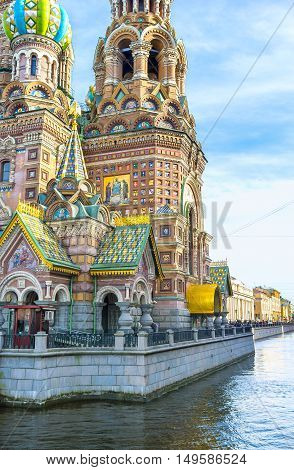 The richly decorated Cathedral of the Savior on Spilled Blood with the colorful roof tiles painted and mosaic icons and patterns gilt carved metal lace St Petersburg Russia.