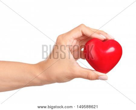 Female hand with red heart isolated on white