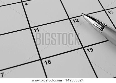 Pen on calendar, closeup. Physiotherapy concept
