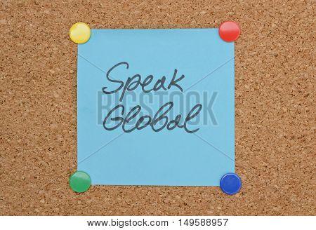 Text Speak Global written on a sticker pinned on a cork board