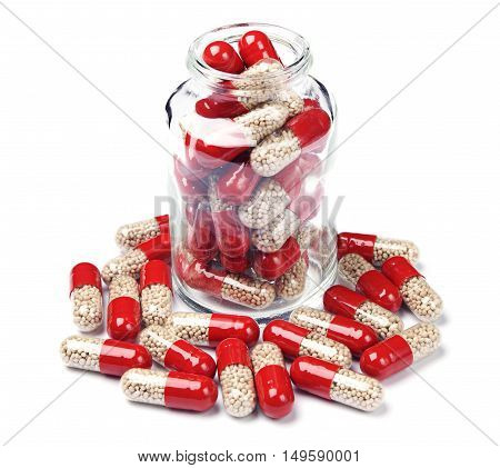 Glass bottle with capsule pills on white background