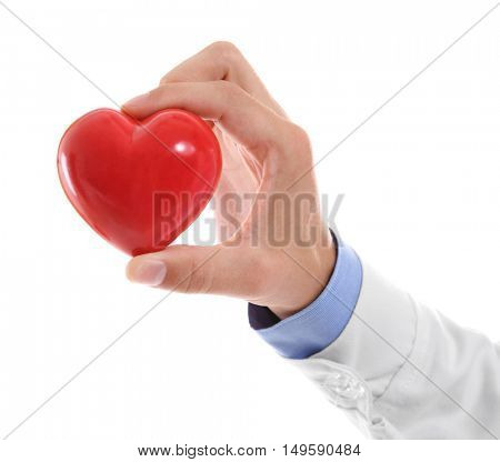 Male doctor holding red heart on white background