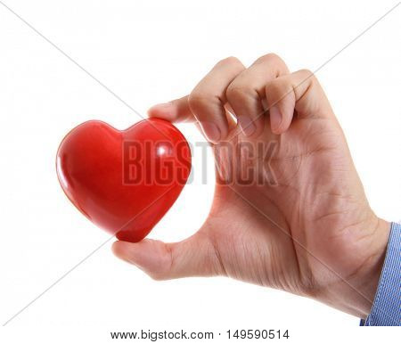 Male hand holding red heart on white background