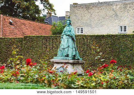 September, 22th, 2015 - Copenhagen, Denmark. Queen Caroline Amalie of Augustenburg statue in rose Garden near Rosenborg Castle.