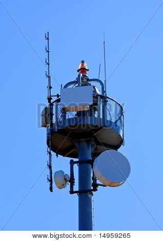 Microwave communications tower with antennas