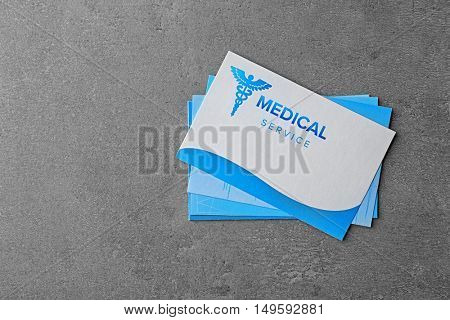 Medical service concept. Visiting cards on grey background