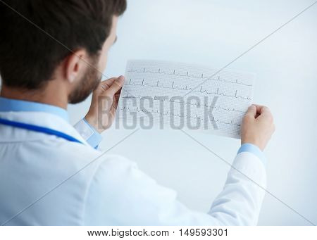 Male doctor at work in clinic office