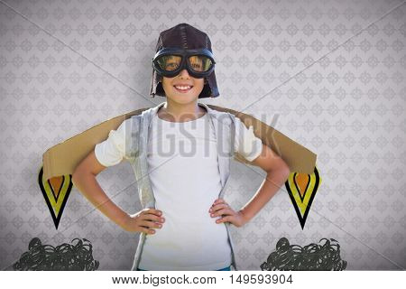 Boy pretending to be an aviation pilot against room with wooden floor