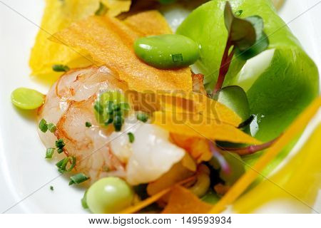 Salad with scallops and shrimp.