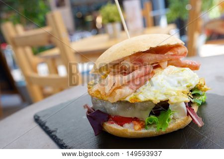 Burger with fried egg and bacon.