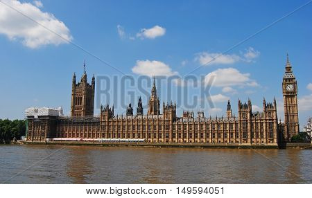 London, United Kingdom - June 21, 2014. The Houses of Parliament on Thames River waterfront in London.
