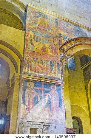 MTSKHETA GEORGIA - JUNE 6 2016: The wall in Svetitskhoveli Cathedral decorated with preserved medieval frescoes on June 6 in Mtskheta.