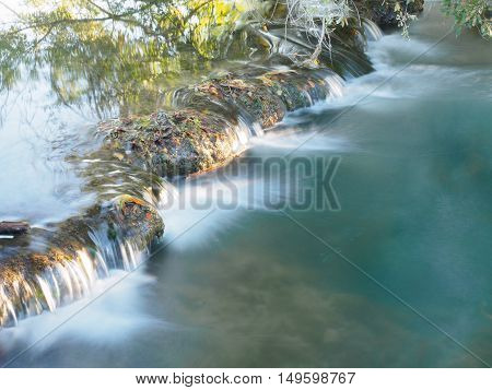 River with small waterfall in Aquitaine France
