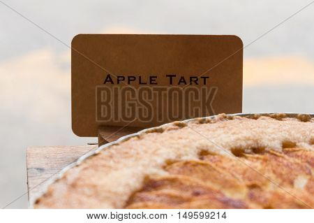 Apple tart with price tag on sale in shop