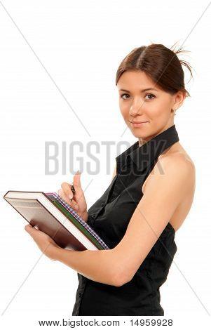 Mujer tenga libros y libros de texto en su mano