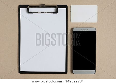 Clipboard With Blank Paper, Card And Smartphone