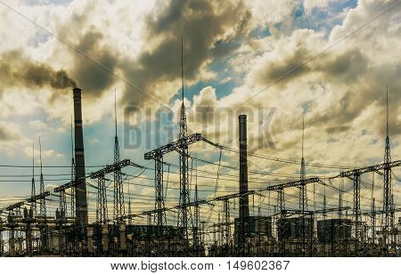 coal power plant with big chimneys and electrical substation on the front