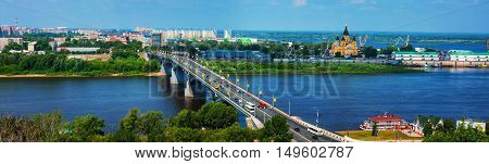 Aerial view at the modern part of Nizhny Novgorod, Russia with bridge over Oka river and various historical buildings