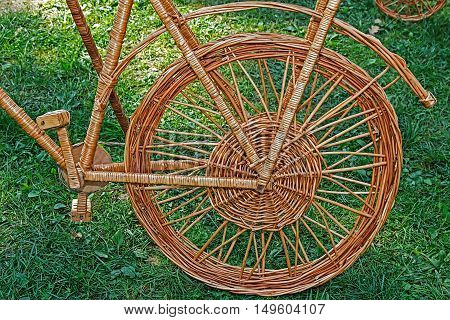 Detail of decorative bike for ornamental garden made from twigs and wicker.