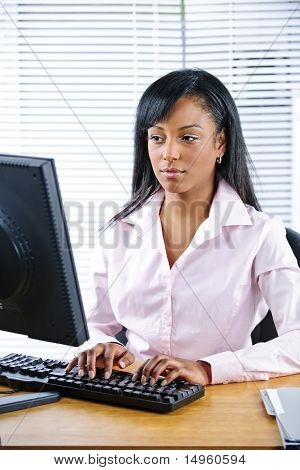 Serious Black Businesswoman At Desk