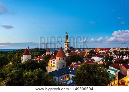Aerial view of Tallinn, Estonia at sunset. Night over old town with illuminated buildings