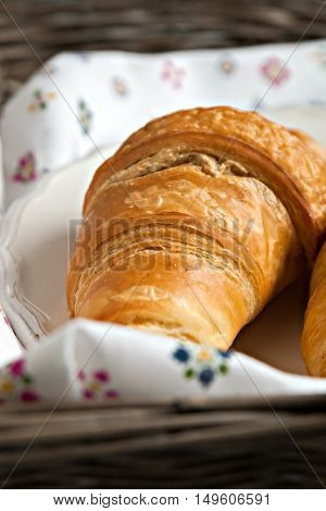 Croissants In The Romantic Style In A Wicker Basket