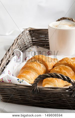 Croissants, Coffee Cup, Flower In Romantic Style On A Wicker Tray On White Bedding