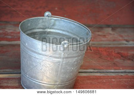 Abstract water bucket on a floor indoors.