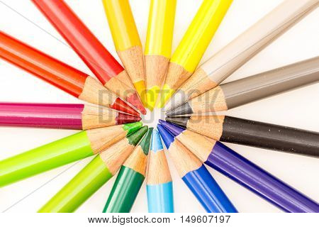Bunch Of Colorful Pencils Set In Circle With Tips In Center , On White Background