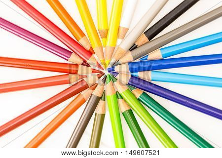 Bunch Of Colorful Pencils Set In Circle With Tips Pointing Center , On White Background