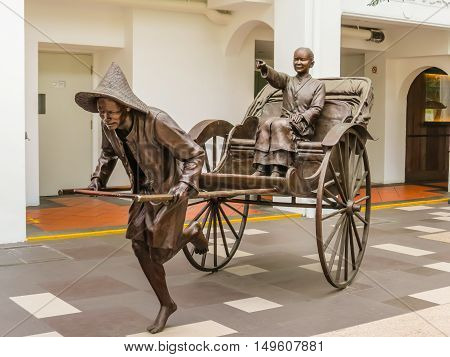 SINGAPORE, REPUBLIC OF SINGAPORE - JANUARY 09, 2014: Sculptures of Chinese rickshaw in the Telok Ayer area, Singapore